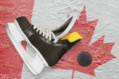 Puck, skates and Canadian flag Stock Photos