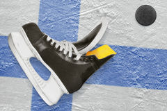 Puck, skates and Finnish flag Stock Photography