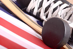 Puck, skates and hockey stick of the American flag Royalty Free Stock Photos