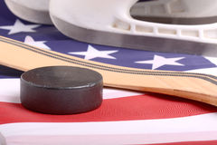 Puck, skates and hockey stick of the American flag Royalty Free Stock Image