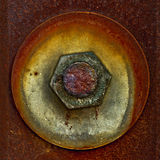 Puck wound up on a rusty bolt Royalty Free Stock Images