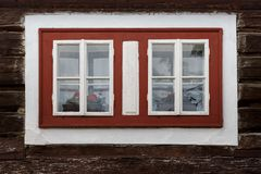 Pucov village in Orva region. Windows of a traditional log cabin, Orava region, Slovakia royalty free stock photography