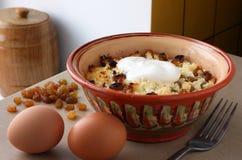 Pudding. Bowl of pudding at a lay eggs and raisins Stock Photo