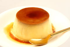 Pudding. Baked pudding with caramel on the white plate stock images