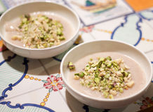 Pudding blancmange decorated with almond and pistachio. Homemade pudding blancmange decorated with almond and pistachio grain royalty free stock photography