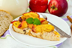 Pudding from bread and peaches with milk on light board Stock Photography