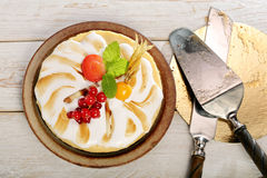 Pudding cake with fruit on a wooden background stock photo