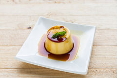 Pudding Caramel Custard in white plate. Stock Photo