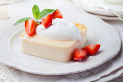 Pudding, cheesecake, custard dessert, with sour cream and fresh strawberry and mint leaves Royalty Free Stock Photo