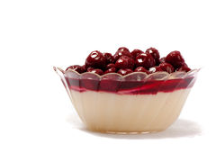 Pudding with cherries. Stock Images