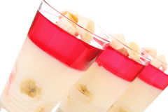 Pudding desserts. With bananas and raspberry jelly stock photos