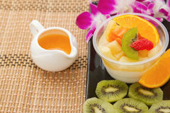 Pudding fruit salad with orange juice, fusion dessert Stock Photos