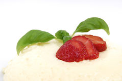 Pudding with Strawberry. Two Strawberries in front of a vanilla pudding Stock Photo