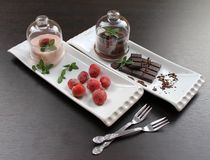 Pudding with strawberry frozen strawberry and mint cream bowls in glass Royalty Free Stock Photography