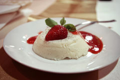 Pudding with strawberry. On the table Royalty Free Stock Photo