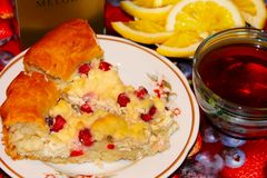 Pudding, tea and lemons. On the table Royalty Free Stock Photography