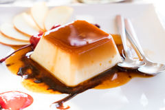 Pudding on white dish and spoon.. Pudding on white dish and spoon Royalty Free Stock Image