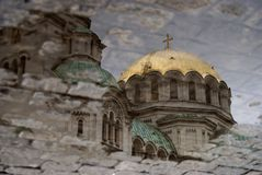 Puddle. Alexander Nevski Church, on a cloudy day Royalty Free Stock Images