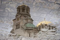 Puddle. Alexander Nevski Church, on a cloudy day Royalty Free Stock Photography