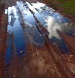 Puddle. Of rainy water with cloud Stock Photos