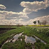 Puddle. At a road and sky with clouds Royalty Free Stock Images