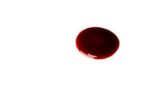 Puddle of blood. On white stock photos