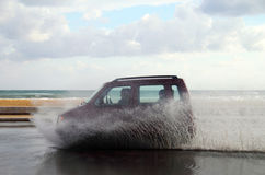 Puddle and car. Reckless driving with the puddle on the road Stock Photos