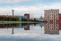 Puddle City Reflection, Norilsk stock photos