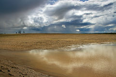 Puddle on a field. Royalty Free Stock Photos
