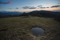 Puddle on field during sunset near Freiburg Stock Images