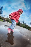 Puddle fun Royalty Free Stock Photo