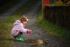 Puddle Fun Royalty Free Stock Photography
