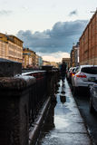 Puddle on the granite embankment Griboyedov, white night in St. Stock Image