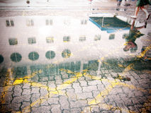 Puddle mirror, Cruise ship Royalty Free Stock Image