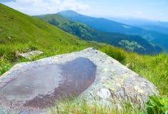 Puddle on mountain stone Stock Image