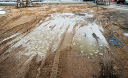 Puddle and mud with truck wheel track at construction site in rainy day. Puddle and mud with truck wheel track at construction site Royalty Free Stock Photos