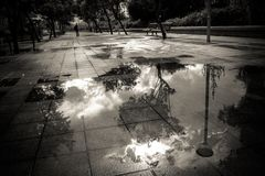 Puddle on the pavement Royalty Free Stock Photography