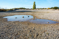 Puddle after a rain in a stone quarry Stock Photo