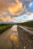 Puddle in sunset colors Stock Photo