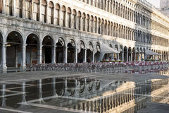 Puddle which reflects Procuratie Vecchie in Piazza San Marco in Venice Stock Images
