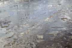 Puddles and chopped ice royalty free stock image
