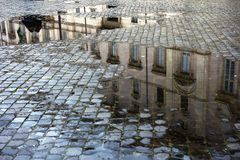 Puddles in a cobbled street of Rome Italy, near stock photo