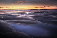 Aberavon beach puddles. Puddles left on the shore after low tide at Aberavon beach in Port Talbot, South Wales, UK Stock Image