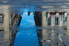 Puddles after rain. Turin historical buildings being reflected in the puddles afer rain. In particolar Po Street from Castle Place Stock Photo