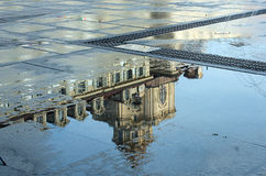 Puddles after rain. Turin historical buildings being reflected in the puddles afer rain. In particular Castle Place Royalty Free Stock Photography