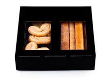 Pudełko słodkiego masła śniadaniowi ciastka na bielu Obraz Royalty Free