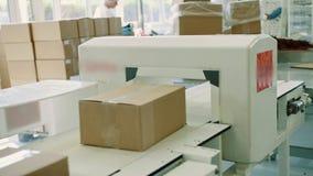 Pudełko z cukierkami na konwejerze Cukierek fabryka zbiory
