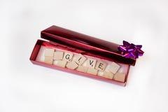 Pudełko z słowem Daje w nim. Zdjęcia Royalty Free