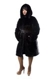 Pudgy brunette in black coat with hood Royalty Free Stock Photography