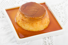 Pudim de Leite. Brazilian flan made with milk and condensed milk, topped with caramel sauce Stock Photos